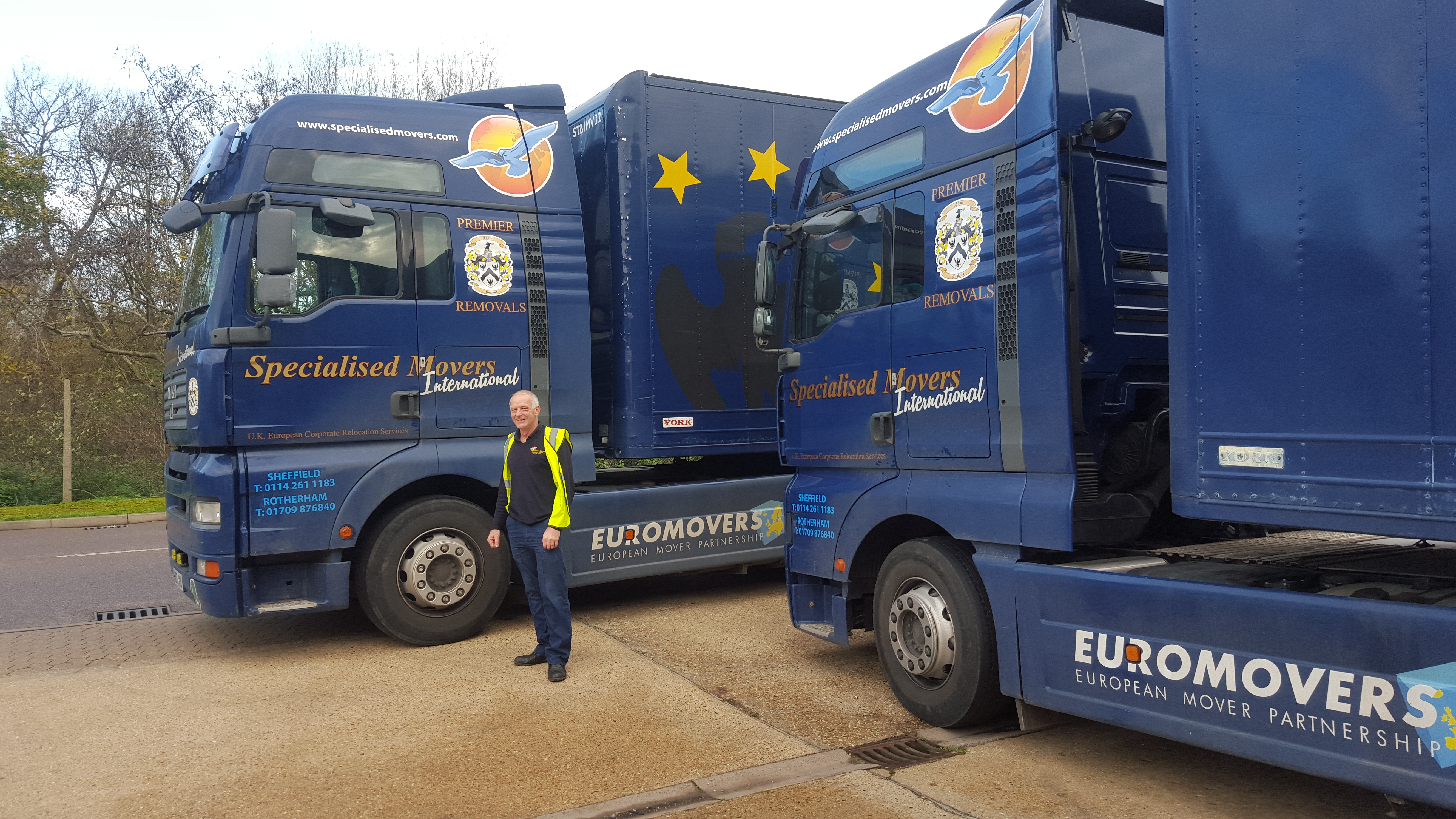 Man stood in front of Specialised Movers Trucks
