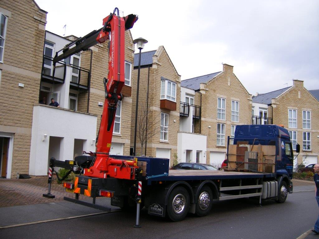HIAB Truck moving objects to balcony