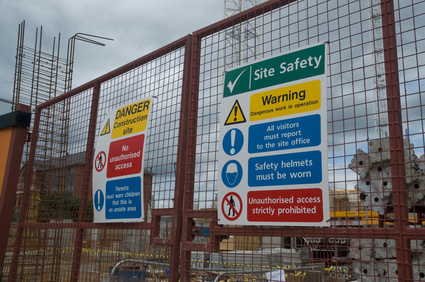 Site gates with health and safety information on them